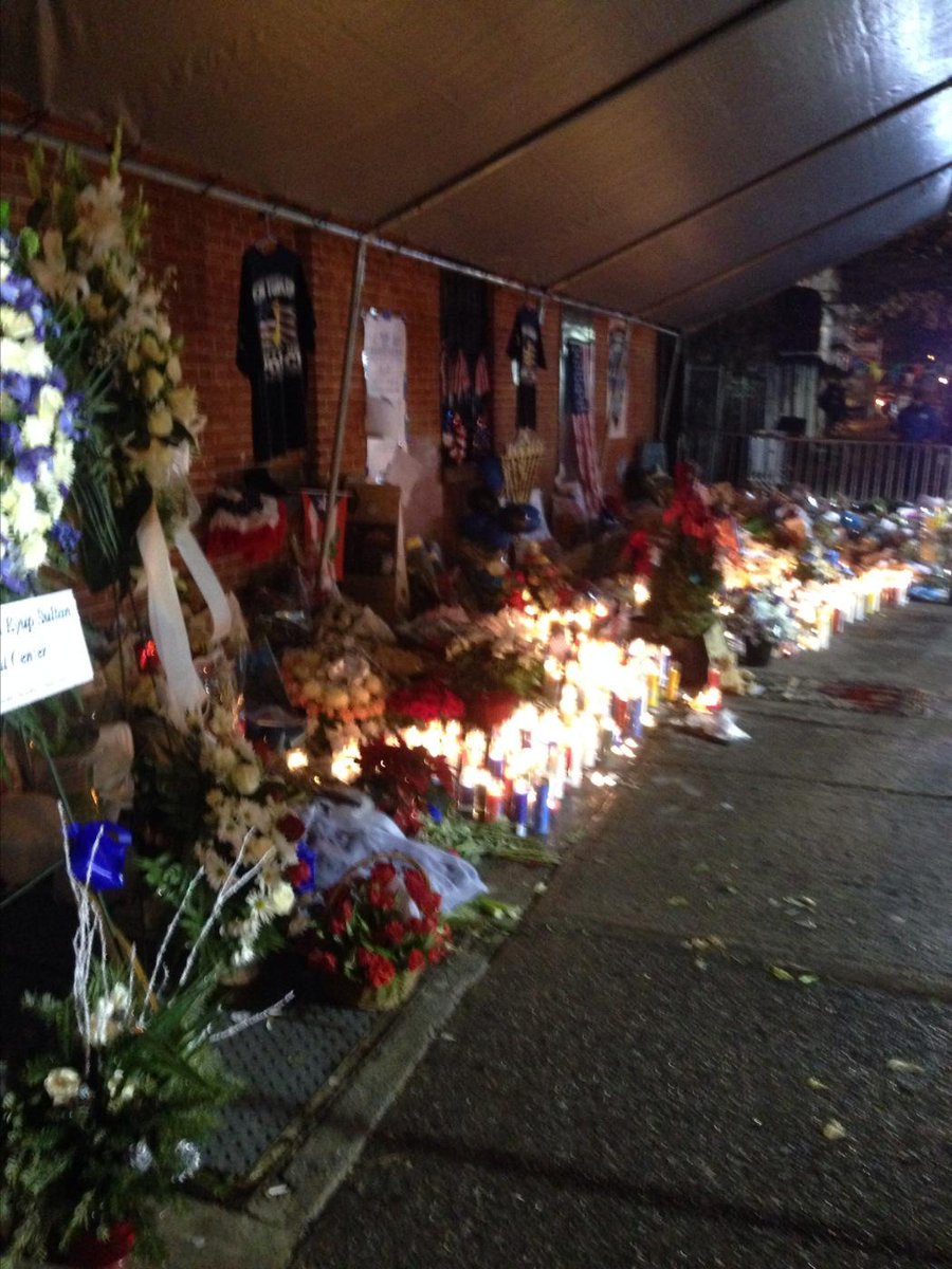 Tent keeping candles handwritten letters from rain tears and prayers for officers killed in Brooklyn #pix11news 5-9am http://t.co/jmY1e0ivWH