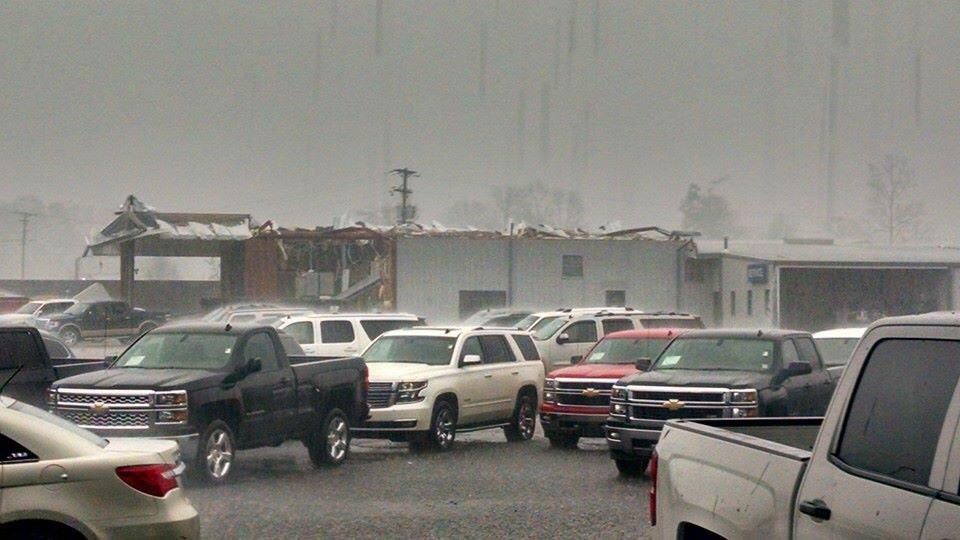 #TorndaoDamage in #Columbia, MS. The roof taken off this car lot. via Jeremy Barnett via @wdam FB page. http://t.co/zjeM8BeBPc