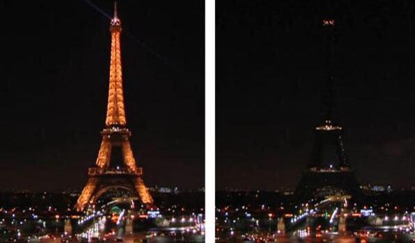 Luci spente alla Torre Eiffel di Parigi (Francia)