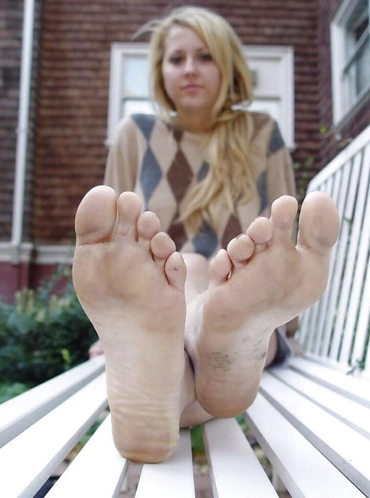 Beautiful blonde amateur teen showing her sexy feet in cute pajama