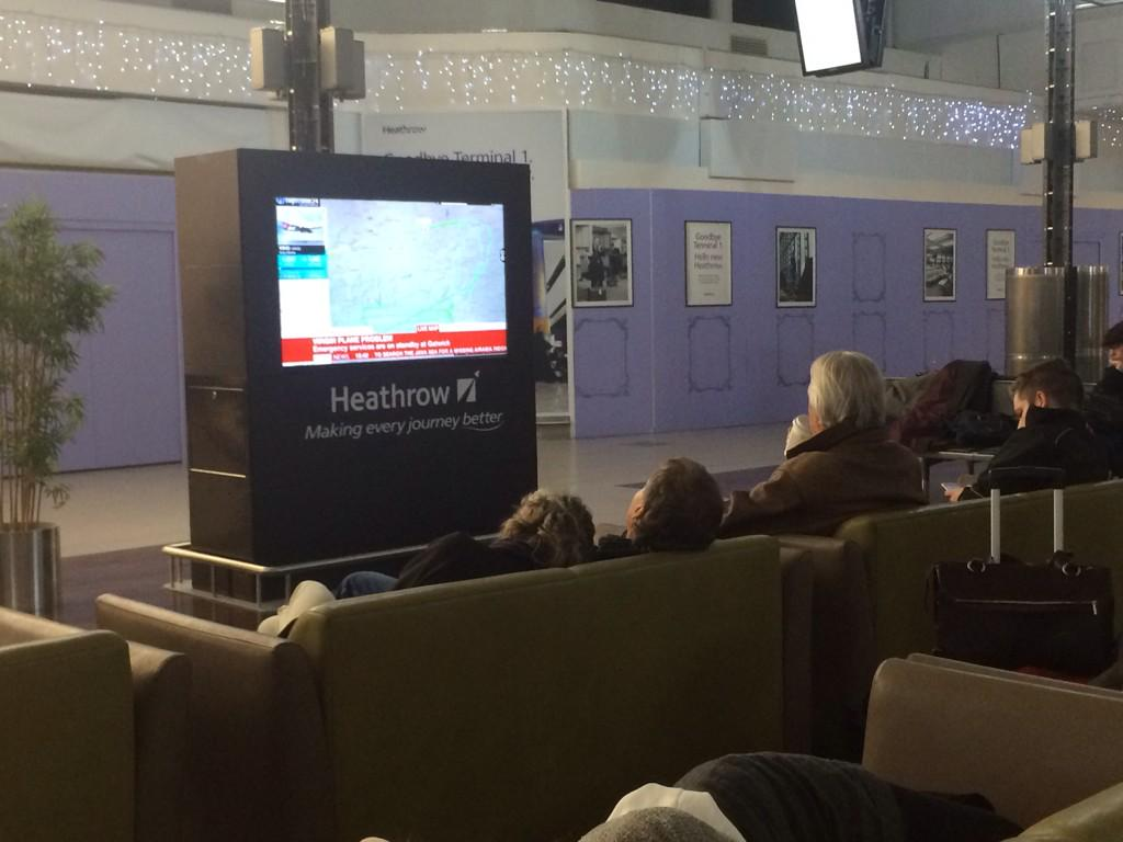 Relax before your flight by watching an unfolding plane drama. #VS43 #Heathrow http://t.co/6SWfaaT1do