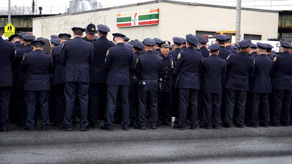 Courage! RT @rx: Two men with enough integrity to not turn their backs on the Mayor at Officer Wenjian Liu's funeral. http://t.co/S7uyuxonws