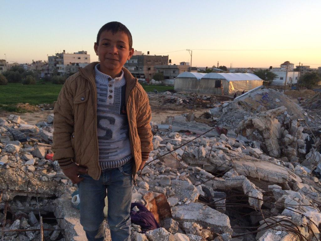 In Khuza'a, Mohammed stands on what used to be his house. 54 more homes surrounding him are completely destroyed. http://t.co/UGQXW9ArcC