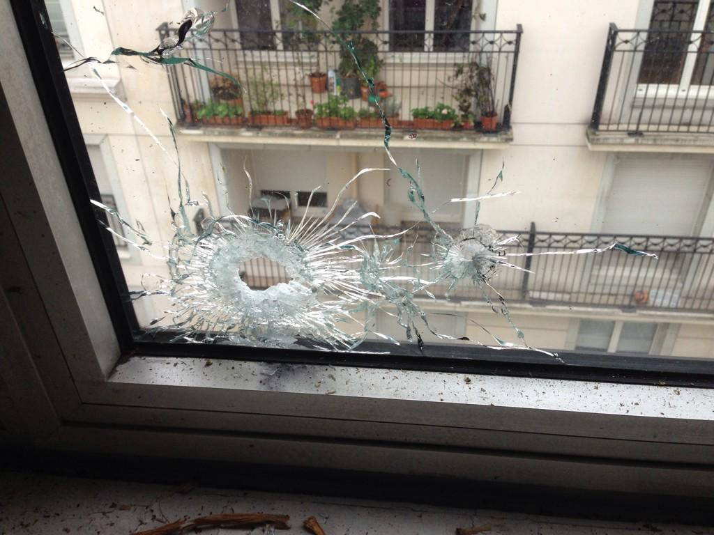 Two bullets went through a door and windows writes @yvecresson at scene of #CharlieHebdo. Dunno whose bullets yet  http://t.co/iuH2QvJLQc