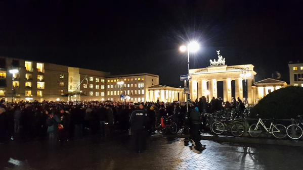 In Berlin, people gather in front of French Embassy to show solidarity after #CharlieHebdo attacks. #JeSuisCharlie http://t.co/LxFJGRshaV