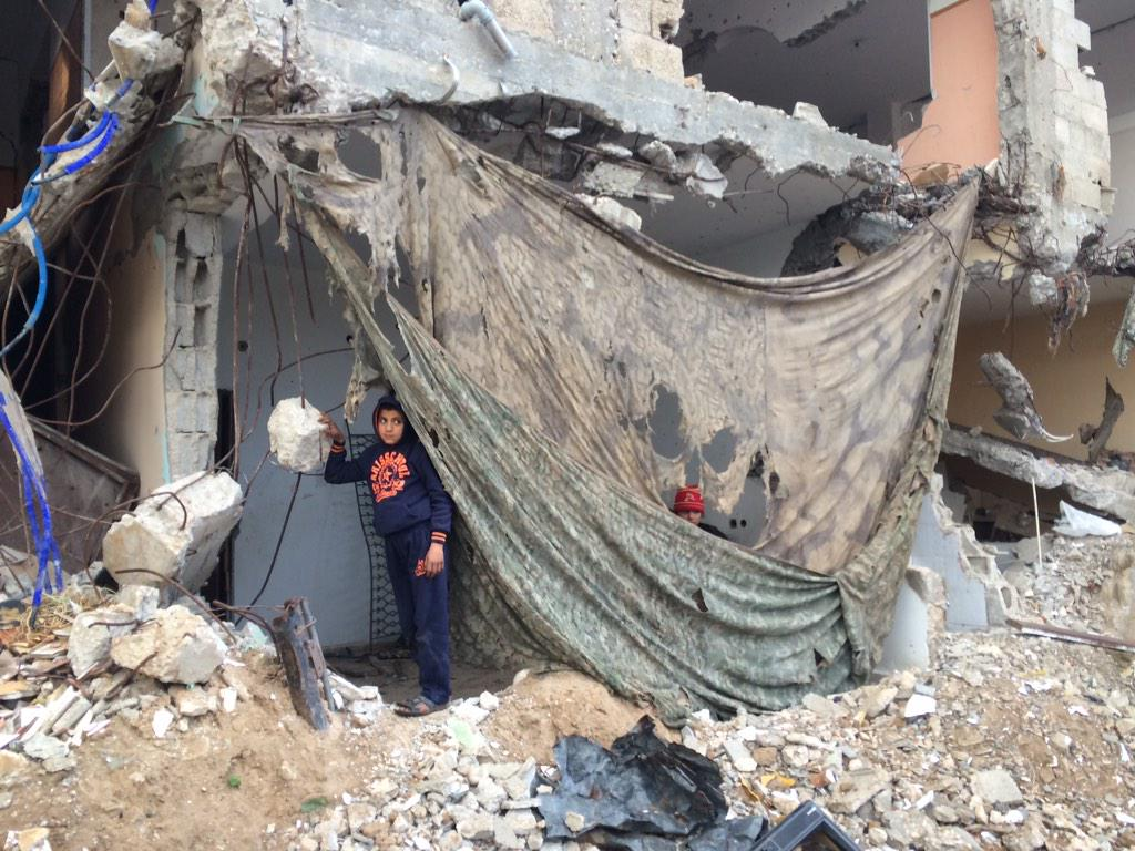 This Shujaiya family uses camouflage netting left by Israeli soldiers to stop the rain & wind. It doesn't help much. http://t.co/2W5IKZNd5W