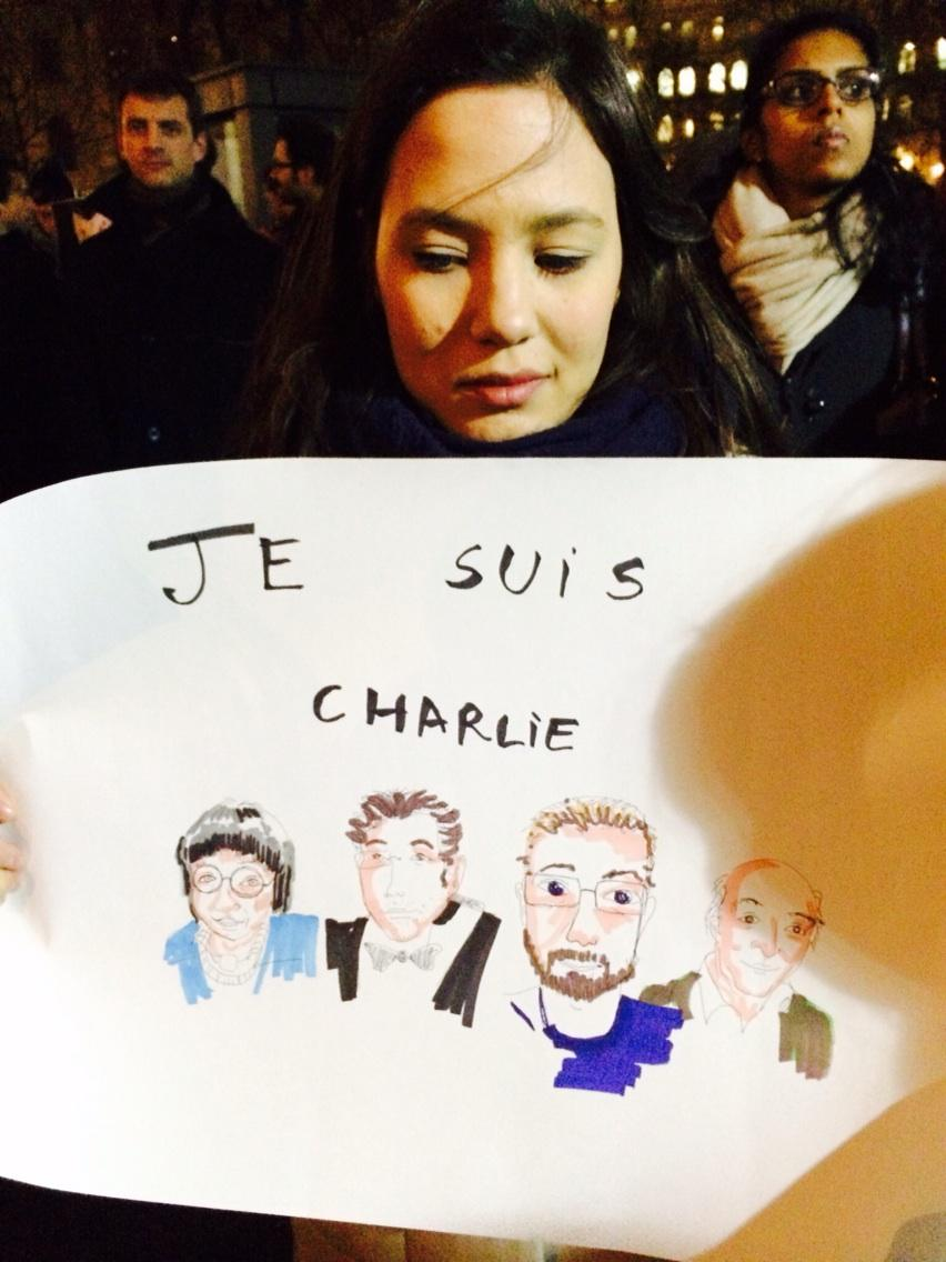 Camille Rousseau, a French student in London holds up the drawing she made to honour #charliehebdo http://t.co/8VTJ7e3xyb
