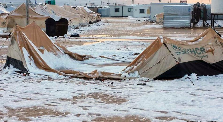 If u feel cold today, look at how #SyrianRefugees live in #Zaatari #Jordan where snow won't give up. pix by @theIRC http://t.co/ug5ZMv6AES
