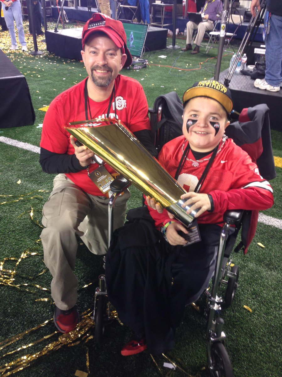 Why We Love Sports Today: Buckeyes fan Jacob Jarvis, 15-year-old with muscular dystrophy, holds trophy after OSU win. http://t.co/RCRDc0vSfK