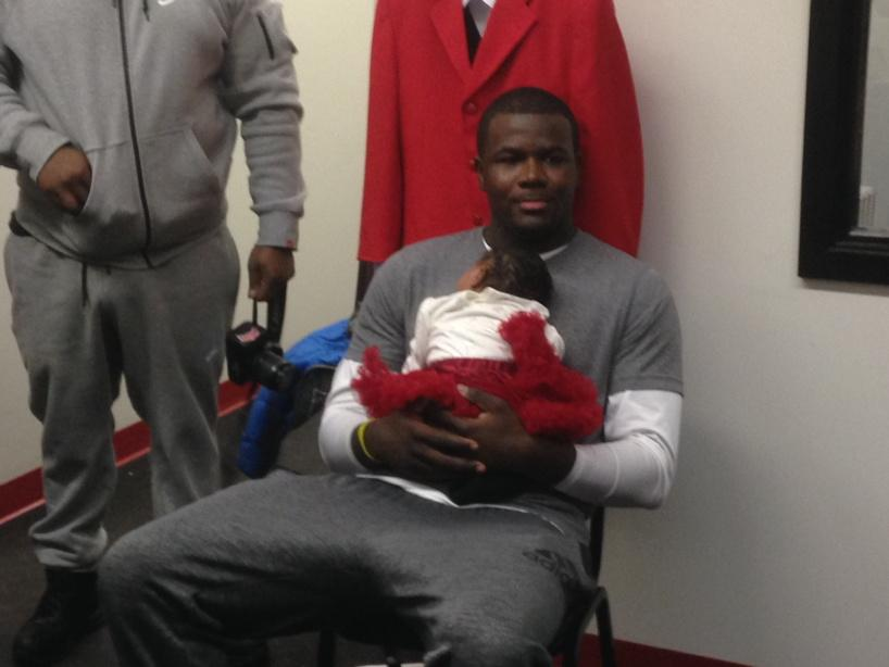 Cardale Jones and his daughter after #CardaleDecision http://t.co/L2ILTtt45q