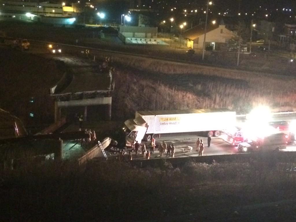 Unbelievable scene on 75 South at Hopple. Overpass collapsed onto highway. Appears 18 wheeler is damaged. http://t.co/kslHenN91q