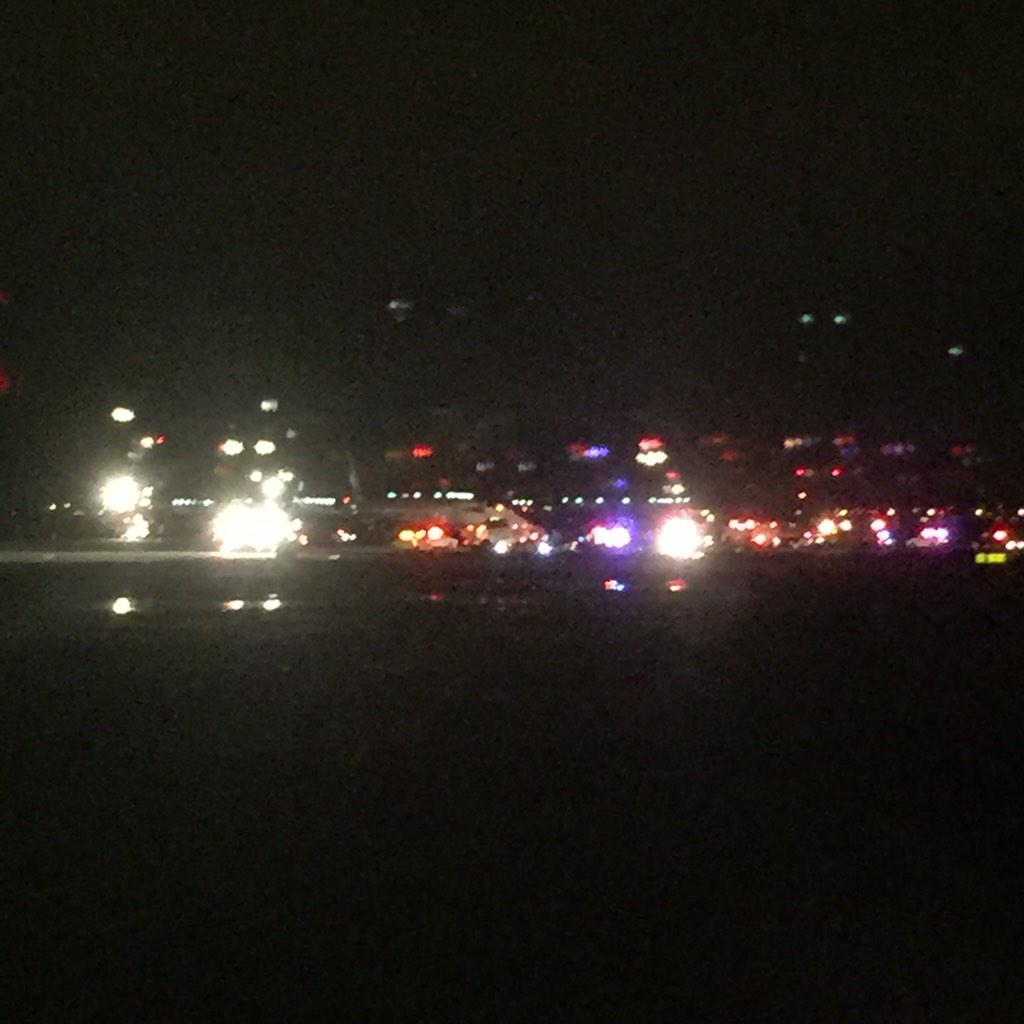 situation on the runway at JFK: plane surrounded by fire and medical, passengers are walking across the Tarmac http://t.co/i3oifGnLcm