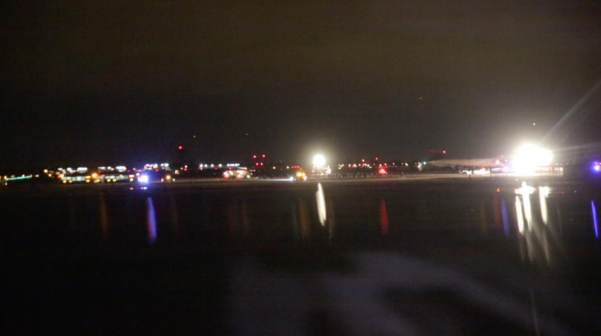 shot some footage from my airplane window of people deplaning #delta468 after a bomb threat, this is a screengrab http://t.co/MkCjTuYMVU
