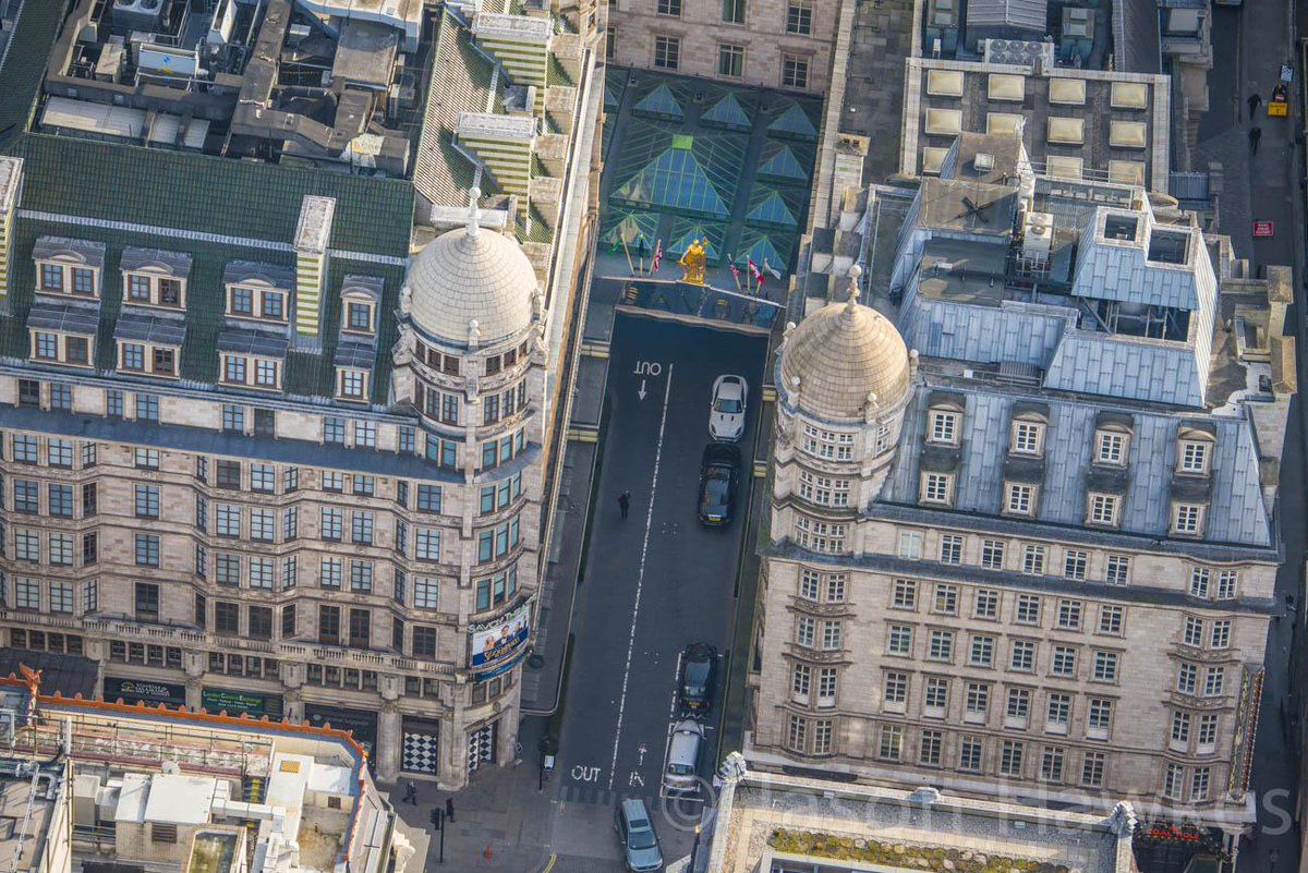 """Great shot! """"@jasonhawkesphot: Looking down into #SavoyCourt #London. Note cars driving on right hand side. http://t.co/kNhiyHBwKd"""""""