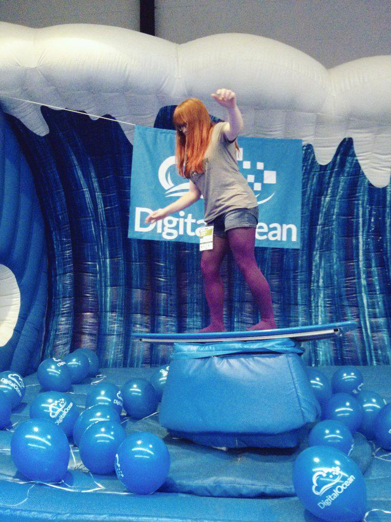 Our brave @michellesanver doing the first test-run in the surf simulator! :D get ready! #phpbnl15 @digitalocean http://t.co/TAMLar1zE0