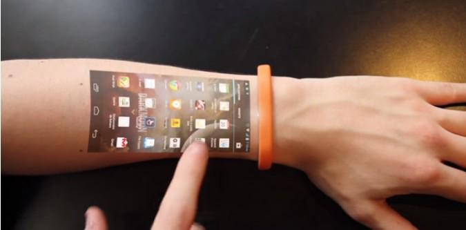 Interesting concept of displaying your phone on your skin #technology #Vancouver http://t.co/OaRq8aPSwX http://t.co/fdCom7t314