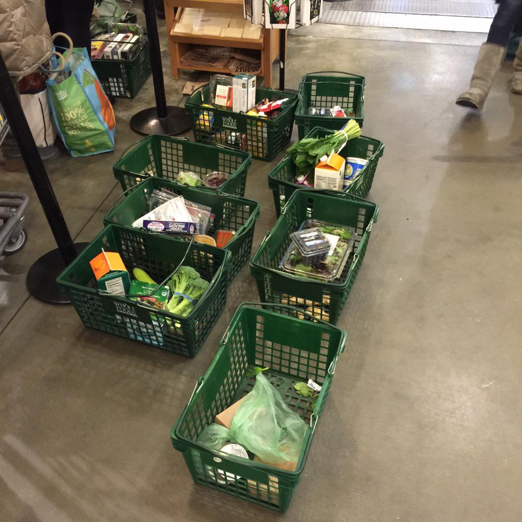 Abandoned baskets at 14 st whole foods from those who could not take the line. @DNAinfo http://t.co/AijoBqvPPY