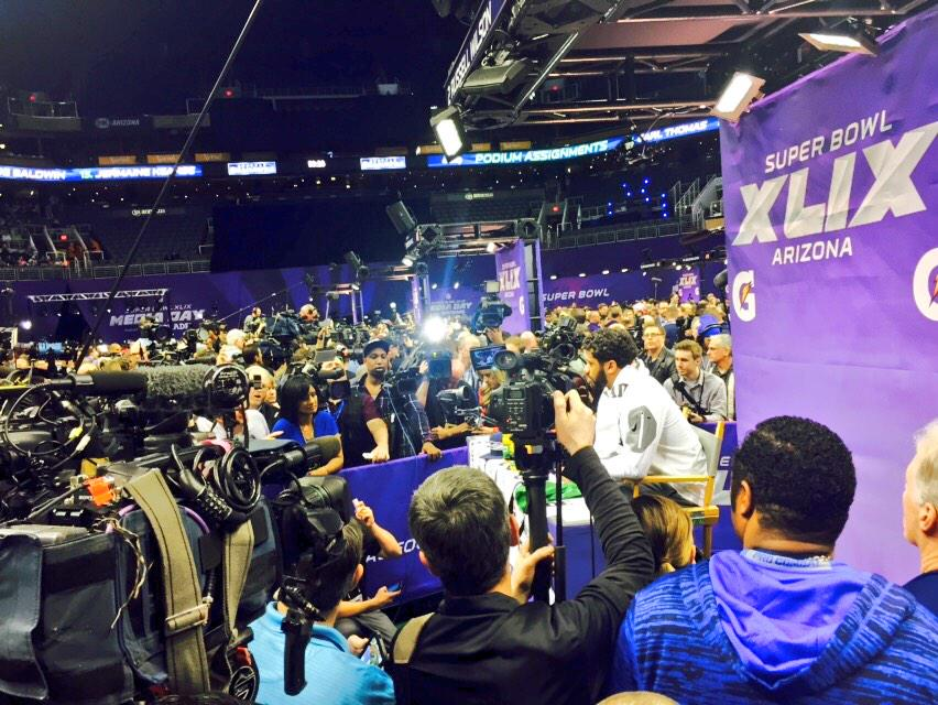 Now he's here. Getting a shot means squeezing in and holding your breath. #SBMediaDay #SB49 #12son7 http://t.co/tYeMYiOdH2