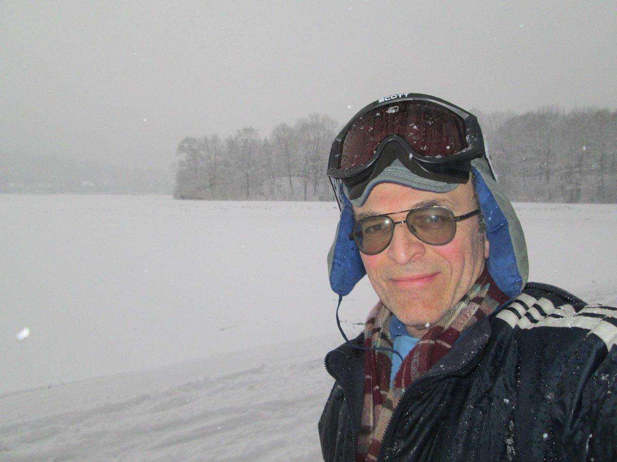 Gregory Piatetsky skiing around a reservoir