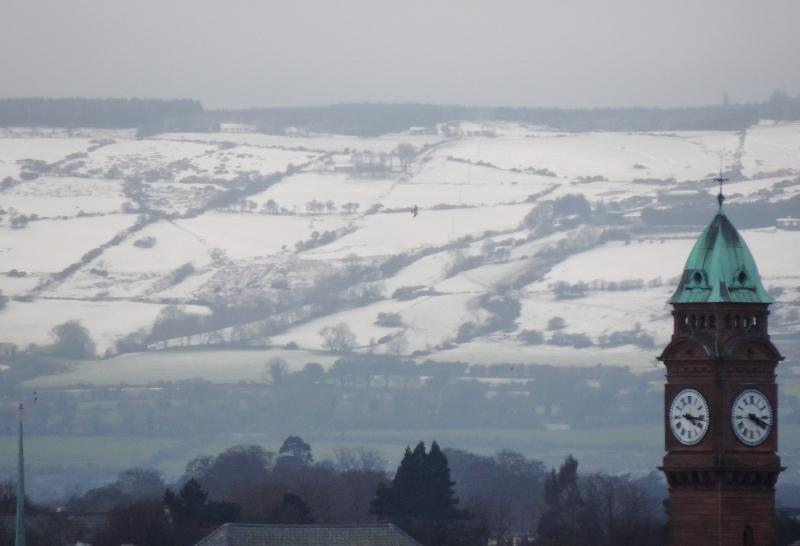 #Snow covered #Dublin Mountains, 29.01.2015 (3). Rathmines Town Hall clock tower in foreground. http://t.co/Y7pjkboovu