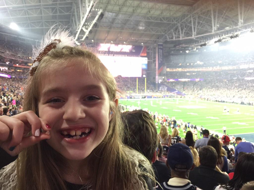 Mission accomplished. First tooth ever pulled at a Super Bowl. (According to her)... #SB49 http://t.co/Q4xoEq1Qod