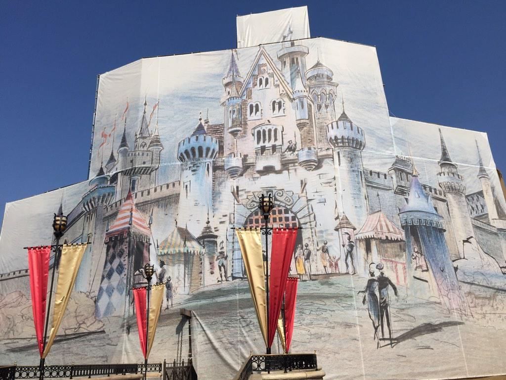 A decorated scrim hides Sleeping Beauty Castle as #Disneyland60 preparations get underway. Photo via @Curlyxz http://t.co/suUDtTXkbD