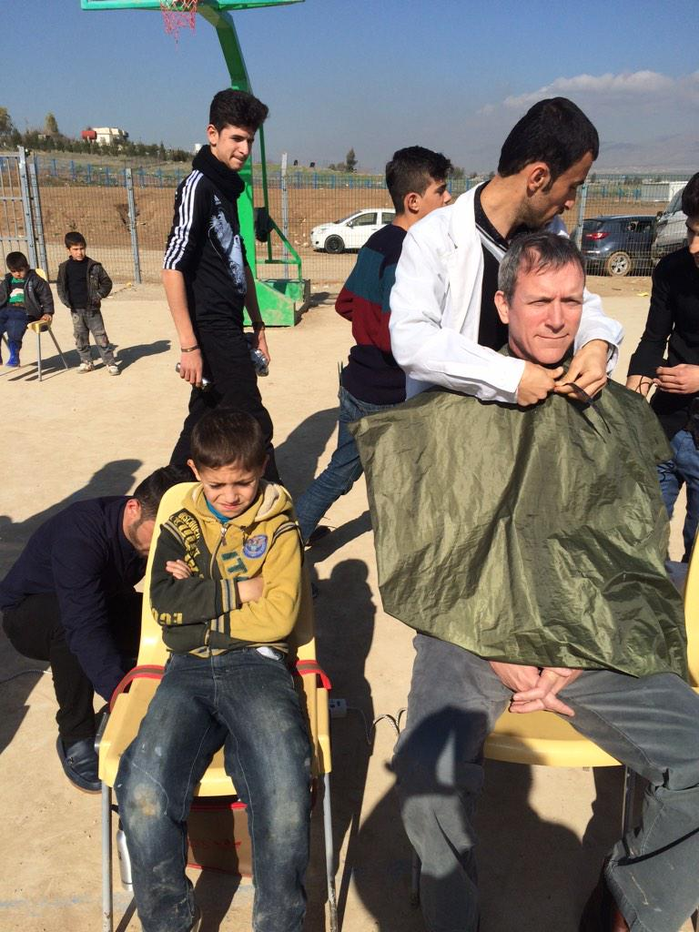 .@theIRC @TomGarofalo gets ready for free cut from local barbers who give #SyrianChildren kids hair free http://t.co/J3XqrnBEvq