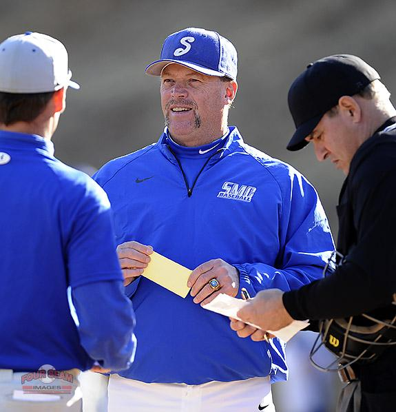 @GOSMCBASEBALL Head coach Tim Wallace exchanges lineup cards in the opening homestand against Surry on Saturday. http://t.co/fbrwxIAfvo