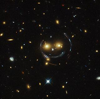 A smiley face lensed galaxy from @NASA_Hubble http://t.co/69KIwCpGYR - a galaxy that @SpaceWarps would like. :) http://t.co/Czd0iI6cAu