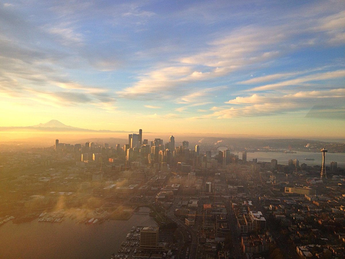 Holy Smoley!!! RT @KenmoreAir: #Sunrise over #Seattle. Has a morning ever looked this good? http://t.co/NDnLvzJJ2B