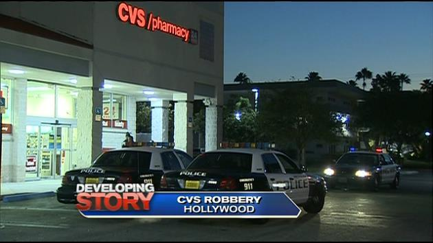 developing police investigating robbery at cvs at 2701 stirling