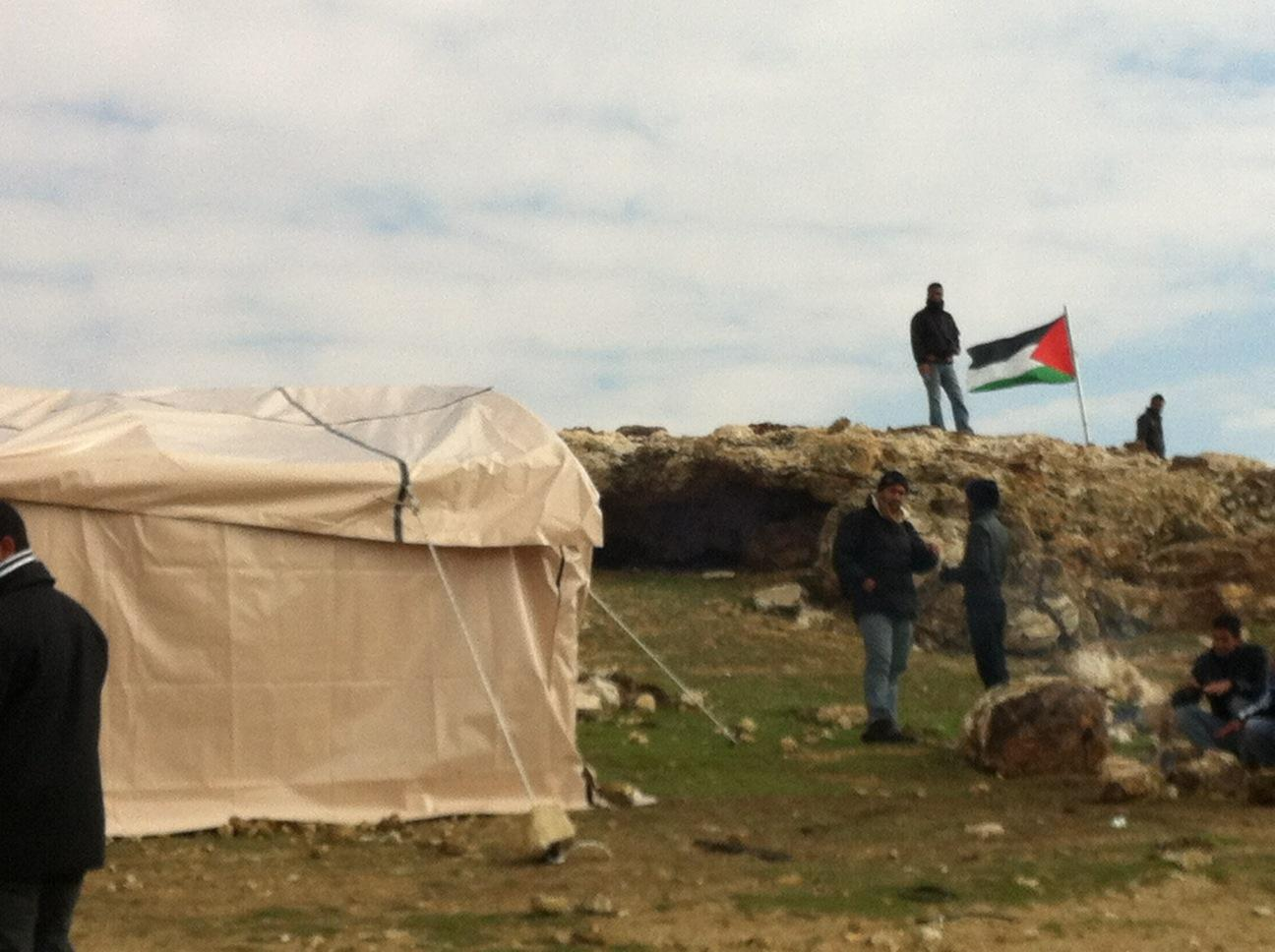 The Palestinian flag was raised today at Bab Al-Shams tent village in E-1
