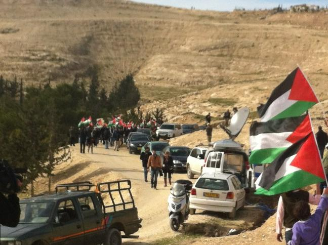 Palestinians arrive in Bab Al-Shams by foot, to avoid roadblocks