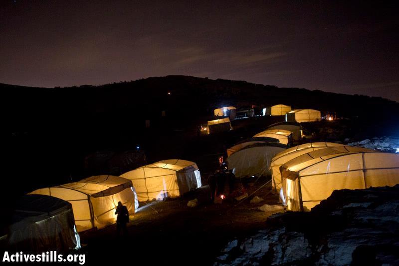 Bab Al-Shams tents peacefully illuminated on Saturday night
