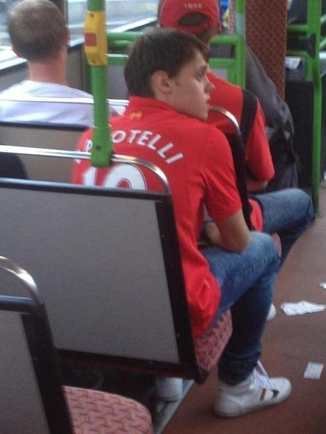 Picture: A Liverpool fan is snapped with Balotellis name on the back of his Reds shirt