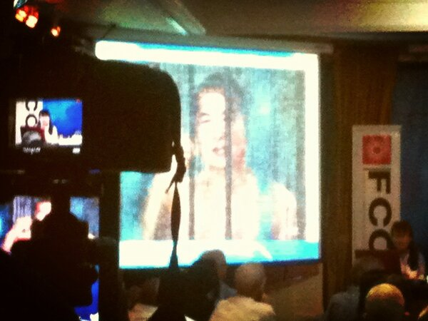 Mrs. Sukanya shows a picture of her husband Somyot behind bars. #lm http://pic.twitter.com/RK3pASA5