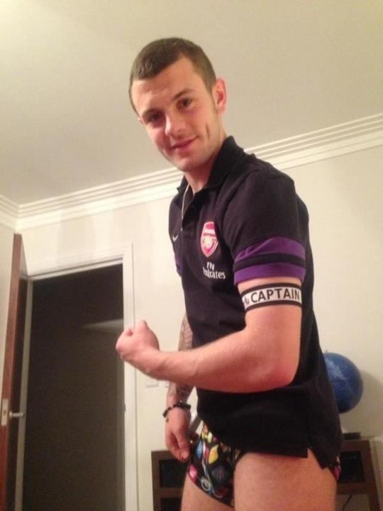 Picture: Jack Wilshere celebrates wearing the Arsenal captain armband taking a snap in his pants