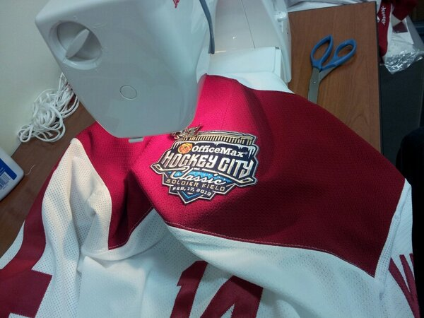 @BadgerMHockey Hockey City Classic patches are going on! #Badgers http://pic.twitter.com/TtDURpCW