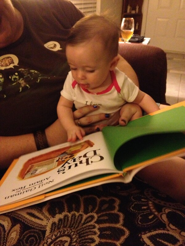 "Reading @neilhimself 's ""Chu's Day"" with my niece (@micaelaruiz63 ) even at 4 months she's a fan! http://pic.twitter.com/UO2dLtxa"