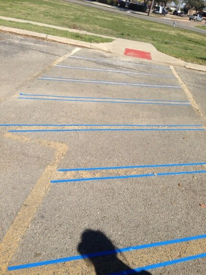 Laying down tape to paint the lines in the parking lot. #UTproject @TexasAPO #service http://pic.twitter.com/n4WzBH3t2v