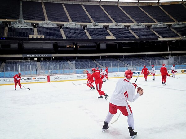 This is Soldier Field. You gotta throw the pigskin around right!? @BadgerMHockey #HCC http://pic.twitter.com/wNd6fivz