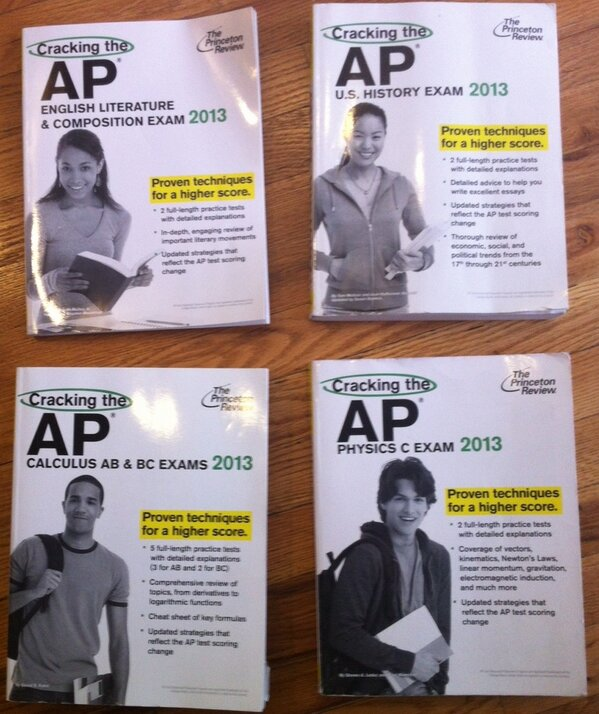 Four AP review books. The history and literature books feature female students, while the calculus and physics books feature male students.