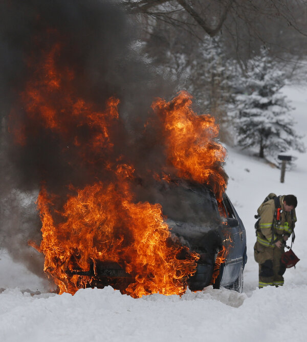 Insane image -- firefighter prepares to battle car fire in the Lawrence, Kansas #snow (AP Photo): http://pic.twitter.com/WJFzhDjyDX