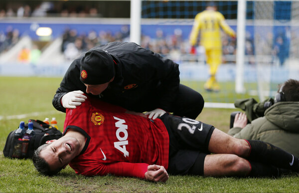 WTF! Robin van Persie taken off at QPR due to collision with a photographer