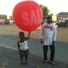 Midget holding a balloon