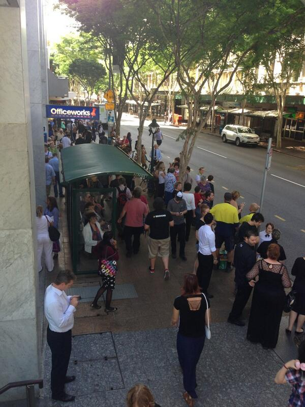 Adelaide St traffic diverted, shops closed, evacuated pedestrians everywhere due to gunman in the mall http://pic.twitter.com/JsA2Kf46vb