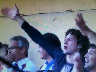 Newcastles Fabricio Coloccini sings for San Lorenzo as he watches a game in the stands