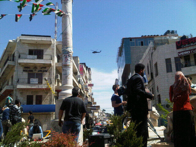 American helicopter - perhaps the one carrying Obama - flying over Ramallah's Manara Square