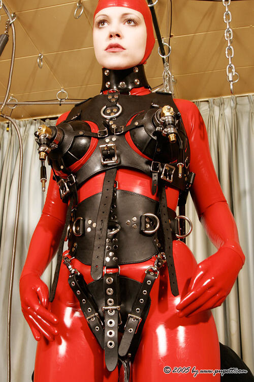 Woman in leather bondage harness