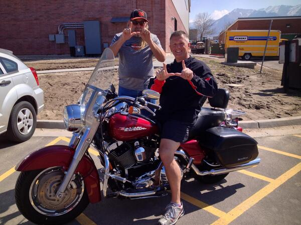 Utah head football coach Kyle Whittingham shows off his new motorcycle.